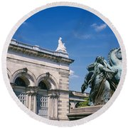 Low Angle View Of A Statue In Front Round Beach Towel by Panoramic Images