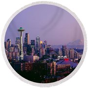 High Angle View Of A City At Sunrise Round Beach Towel by Panoramic Images