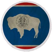 Aged Wyoming State Flag Round Beach Towel by Dan Sproul