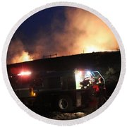 Round Beach Towel featuring the photograph An Engine Crew Works At Night On White Draw Fire by Bill Gabbert