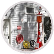 An Old Village Gas Station Round Beach Towel by Mal Bray