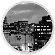 Building Lit Up At Night In A City Round Beach Towel by Panoramic Images
