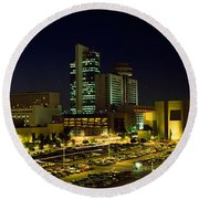 Buildings In A City Lit Up At Night Round Beach Towel by Panoramic Images