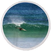 Diving Beneath The Curl Round Beach Towel by Mike Dawson