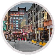 East Fourth Street In Cleveland Round Beach Towel by Frozen in Time Fine Art Photography