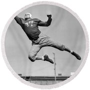 Football Player Catching Pass Round Beach Towel by Underwood Archives
