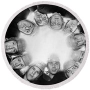 Football Team Huddle Round Beach Towel by Underwood Archives