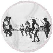 Hoop Jumping Schoolgirls Round Beach Towel by Underwood Archives
