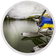 Idle Float Plane At Juneau Airport Round Beach Towel by Darcy Michaelchuk