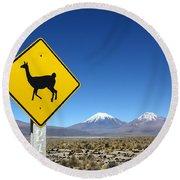 Llamas Crossing Sign Round Beach Towel by James Brunker