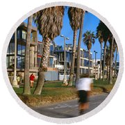 People Riding Bicycles Near A Beach Round Beach Towel by Panoramic Images