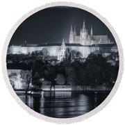 Prague Castle At Night Round Beach Towel by Joan Carroll