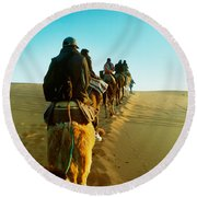 Row Of People Riding Camels Round Beach Towel by Panoramic Images