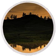 Round Beach Towel featuring the photograph Sunrise Behind A Yellowstone Ridge by Bill Gabbert