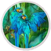 Tropic Spirits - Gold And Blue Macaws Round Beach Towel by Carol Cavalaris