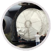 Round Beach Towel featuring the photograph Unloading A Titan Ivb Rocket by Science Source