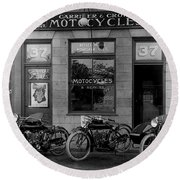 Vintage Motorcycle Dealership Round Beach Towel by Jon Neidert