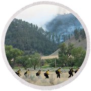 Round Beach Towel featuring the photograph Wyoming Hot Shots Walk To Their Assignment by Bill Gabbert