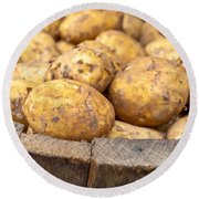 Freshly Harvested Potatoes In A Wooden Bucket Round Beach Towel by Tom Gowanlock