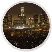 Los Angeles Skyline At Night Round Beach Towel by Bob Christopher