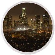 Los Angeles Skyline At Night Round Beach Towel by Bob Christopher