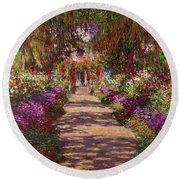 A Pathway In Monets Garden Giverny Round Beach Towel by Claude Monet
