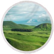 Green Hills On The Big Island Of Hawaii Round Beach Towel by Larry Marshall
