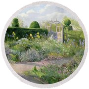 Irises In The Herb Garden Round Beach Towel by Timothy Easton