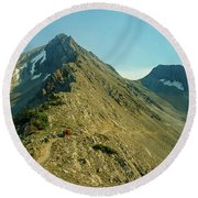Llama Packer Hiking A Steep Rocky Mountain Peak Trail Round Beach Towel by Jerry Voss