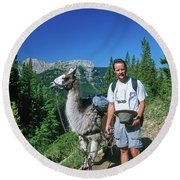 Man Posing With A Llama On A High Mountain Trail Round Beach Towel by Jerry Voss