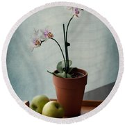 Still Life With Orchids And Green Apples Round Beach Towel by Maggie Terlecki