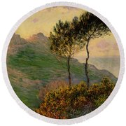 The Church At Varengeville Against The Sunlight Round Beach Towel by Claude Monet