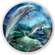 Three Dolphins Round Beach Towel by Carol Cavalaris