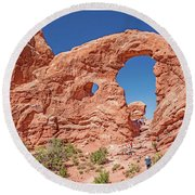 Round Beach Towel featuring the photograph Tourists On Sandstone Arch Formation, Arches National Park by A Gurmankin