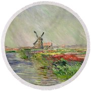 Tulip Field In Holland Round Beach Towel by Claude Monet