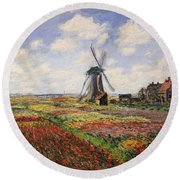 Tulip Fields With The Rijnsburg Windmill Round Beach Towel by Claude Monet