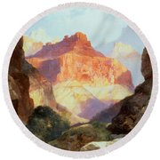 Under The Red Wall Round Beach Towel by Thomas Moran