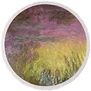 Waterlilies At Sunset Round Beach Towel by Claude Monet