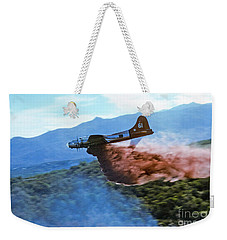 Weekender Tote Bag featuring the photograph  B-17 Air Tanker Dropping Fire Retardant by Bill Gabbert