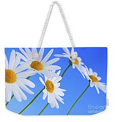 Daisy Flowers On Blue Background Weekender Tote Bag by Elena Elisseeva