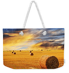 Golden Sunset Over Farm Field With Hay Bales Weekender Tote Bag by Elena Elisseeva
