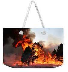 Weekender Tote Bag featuring the photograph A Burst Of Flames From The White Draw Fire by Bill Gabbert
