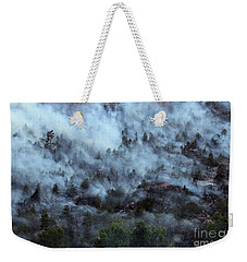 Weekender Tote Bag featuring the photograph A Smoky Slope On White Draw Fire by Bill Gabbert