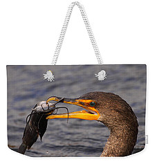 Cormorant Catching Catfish Weekender Tote Bag by Bruce J Robinson