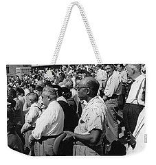 Fans At Yankee Stadium Stand For The National Anthem At The Star Weekender Tote Bag by Underwood Archives