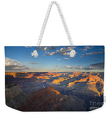 First Light On The Colorado Weekender Tote Bag by Mike  Dawson