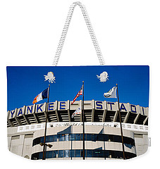 Flags In Front Of A Stadium, Yankee Weekender Tote Bag by Panoramic Images