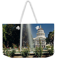 Fountain In A Garden In Front Weekender Tote Bag by Panoramic Images