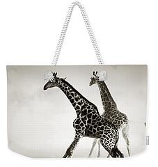 Giraffes Fleeing Weekender Tote Bag by Johan Swanepoel