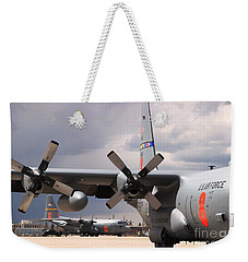 Weekender Tote Bag featuring the photograph Maffs C-130s At Cheyenne by Bill Gabbert